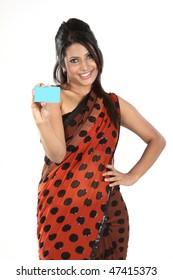 Beautiful woman in sari holding blue blank card