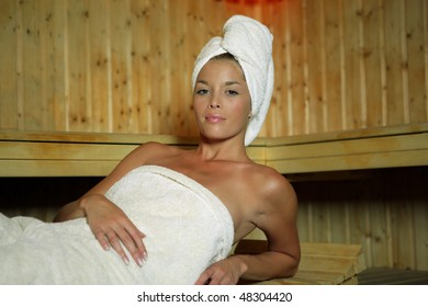 Beautiful woman in a sauna cabin