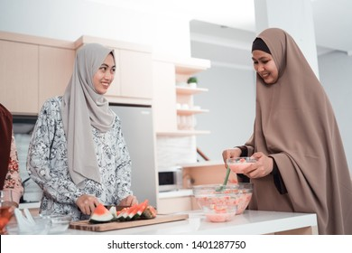 beautiful woman with scarf in the kitchen cooking for dinner with family