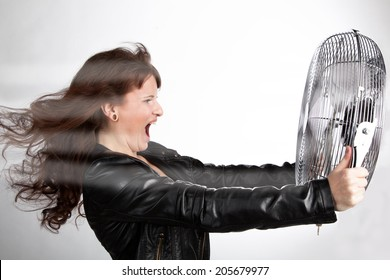 Beautiful woman is screaming with a ventilator in your hands