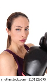 A beautiful woman serious looking with her arms up in black boxing 