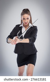 Beautiful woman in serious mood with a martial arts training sword.