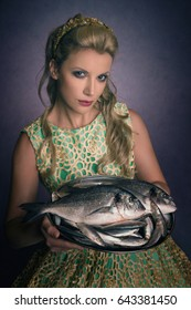 Beautiful woman serving fish