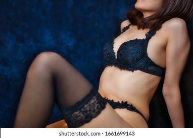 Beautiful woman with sexy luxury black lingerie bra, pantie and garter belt.