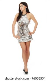 Beautiful woman in shiny sexy dress, isolated on white background