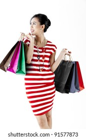Beautiful woman with a lot of shopping bags