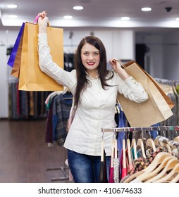 Beautiful woman with shopping bags at fashionable store