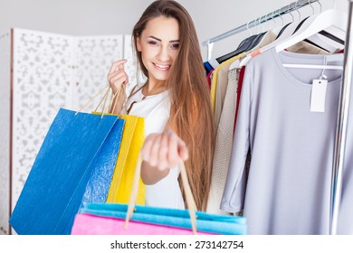 Beautiful woman with shopping bags indoor