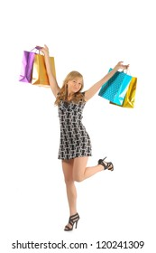 Beautiful woman with a lot of shopping bags. isolated on white.