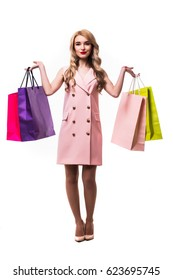beautiful woman with shopping bags. Isolated over white background .