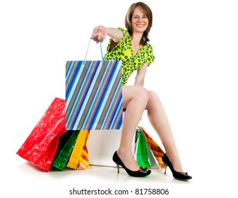beautiful woman with shopping bags on white