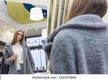 A beautiful woman shopping in a fashion store