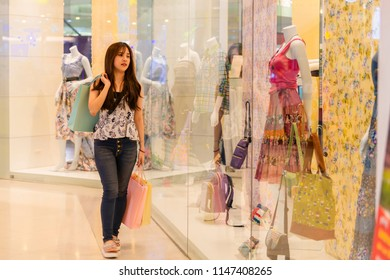 Beautiful woman shopping trendy clothes.