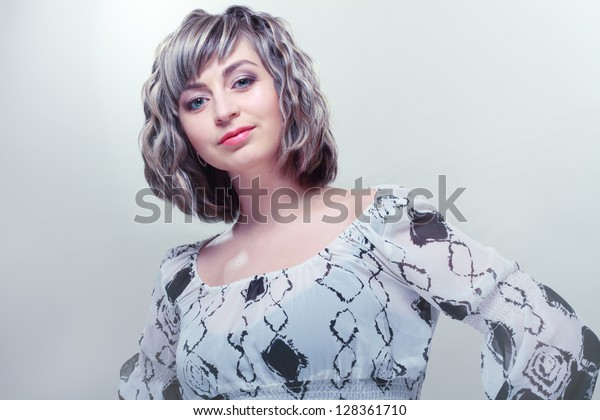 beautiful woman with short hair style. Silver blue tone