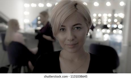 Beautiful woman with short haircut looking at camera