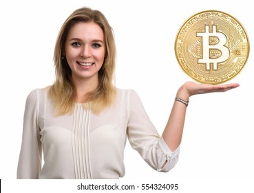Beautiful woman showing Golden Bitcoin coin. Virtual money concept. Cryptocurrency