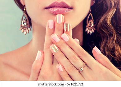 Beautiful woman showing her jewellery and manicure