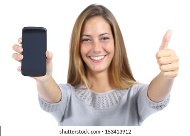 Beautiful woman showing a smart phone with thumb up isolated on a white background