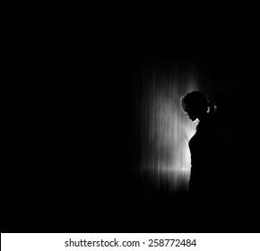 beautiful woman silhouette, black background.