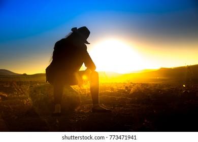 A beautiful woman silhouette at sunset