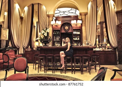 Beautiful woman sitting in the lounge of a luxury hotel