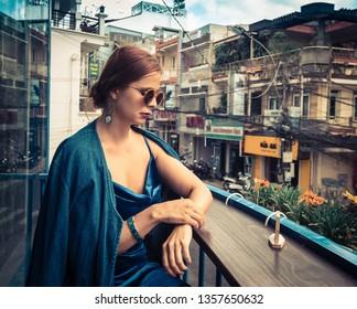 Beautiful woman sitting on cafe terrace in Dalat, Vietnam.