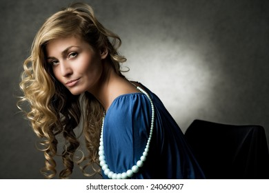 beautiful woman sitting on the chair