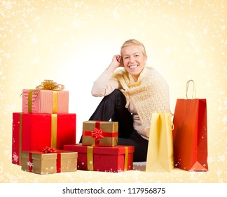 Beautiful woman sitting on the floor surrounded by Christmas presents