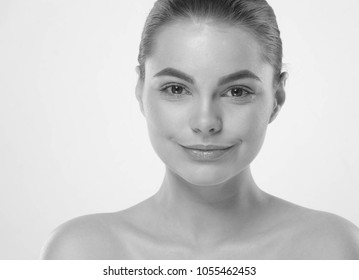 Beautiful woman skin care face close up monochrome isolated on white