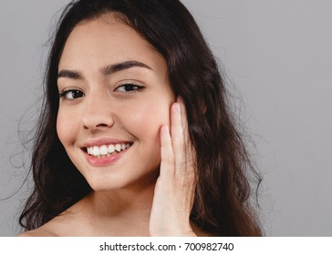 Beautiful woman skincare  beauty face  teeth smile with handscloseup portrait