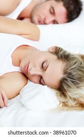 Beautiful woman sleeping in bed with her boyfriend