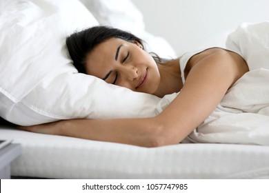 Beautiful woman sleeping in her bed