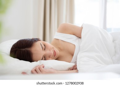 Beautiful woman sleeping on her bed at her bedroom on the holiday.