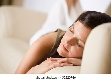 Beautiful woman sleeping on sofa in lounge