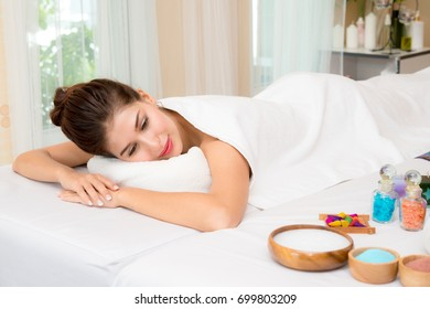 Beautiful woman sleeping on the white bed relax in the spa