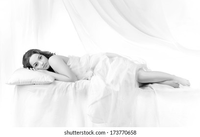 Beautiful woman sleeping over a white background .  Black and white
