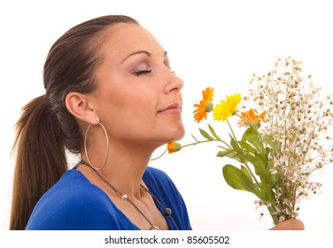 beautiful woman smelling flowers