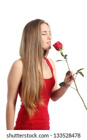 Beautiful woman smelling a red rose isolated on a white background