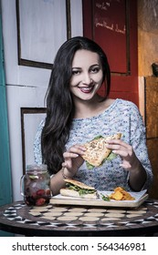 Beautiful woman with smile, eating at old restaurants