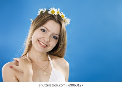 Beautiful woman smiles on a blue background