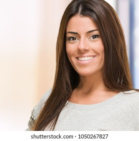 Beautiful woman smiling against an abstract background