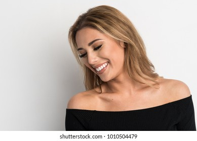 Beautiful Woman Smiling in a Black Off Shoulder Top