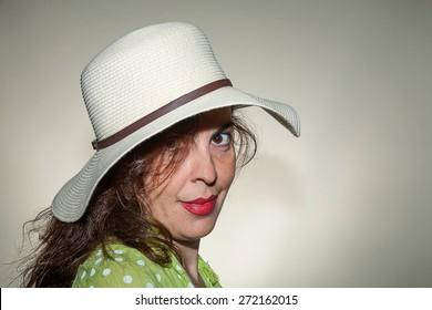 Beautiful woman smiling - close up.Gray background.