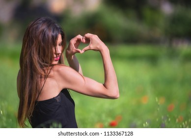 Beautiful Woman smiling. Heart symbol shaped. Love and nature concept. Ecology and sustainability.