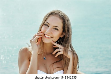 beautiful woman smiling on the beach on sea background beautiful smile face close up