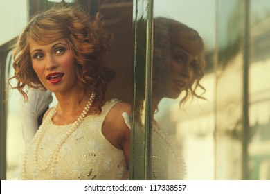 Beautiful woman smiling as she steps from train carriage