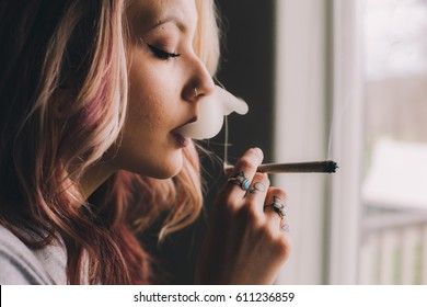 Beautiful Woman Smoking Cannabis Joint