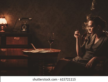 Beautiful woman smoking cigarette in retro interior