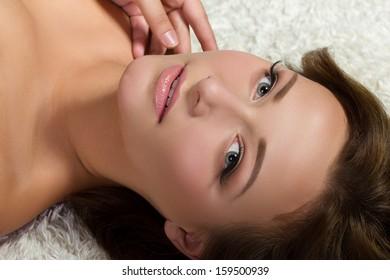 Beautiful woman in spa lying down