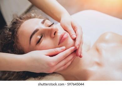 Beautiful woman in spa salon getting facial massage. Relaxing